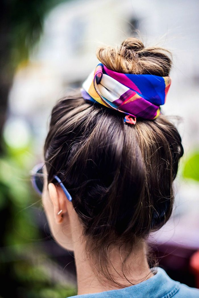 Adding a scarf to a topknot makes for a simple and chic off-duty hairstyle