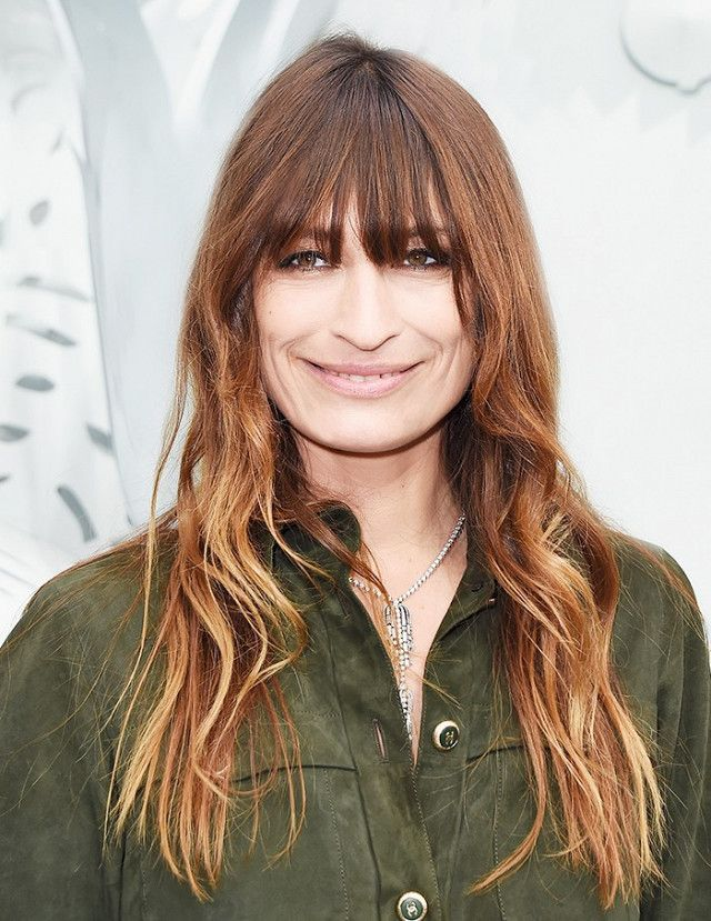 Caroline de Maigret's bold bangs and natural texture are so gorgeous