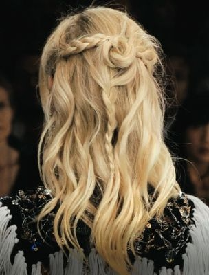 Dare to try an untraditional hairstyle with this hybrid half-up bun and braid si...
