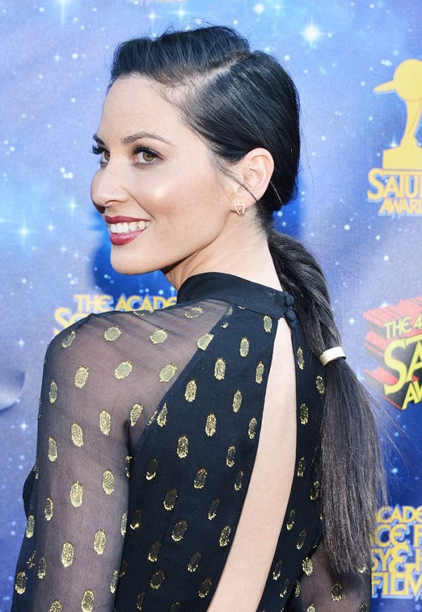 For long-haired ladies, Olivia Munn's braided ponytail keeps hair back while...