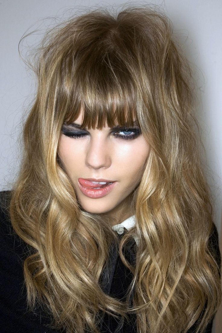 Get '70s-inspired bangs with a longer shag haircut with waves