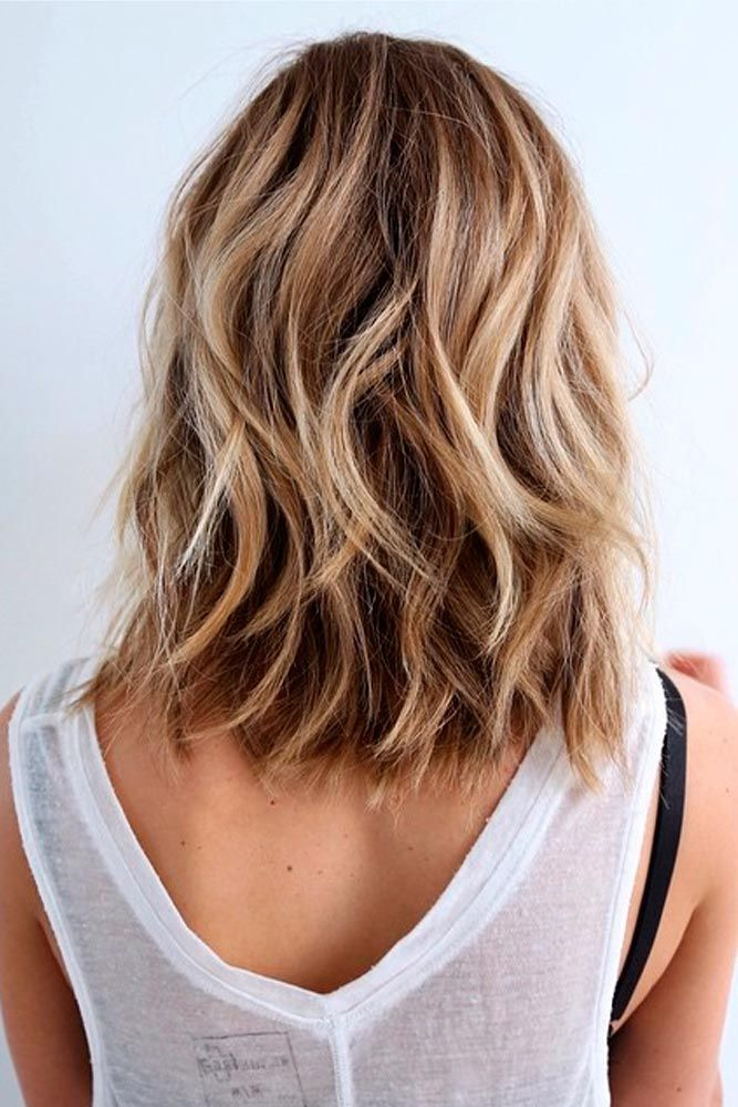 Hairstyles for medium length hair look especially flattering when they are wavy,...