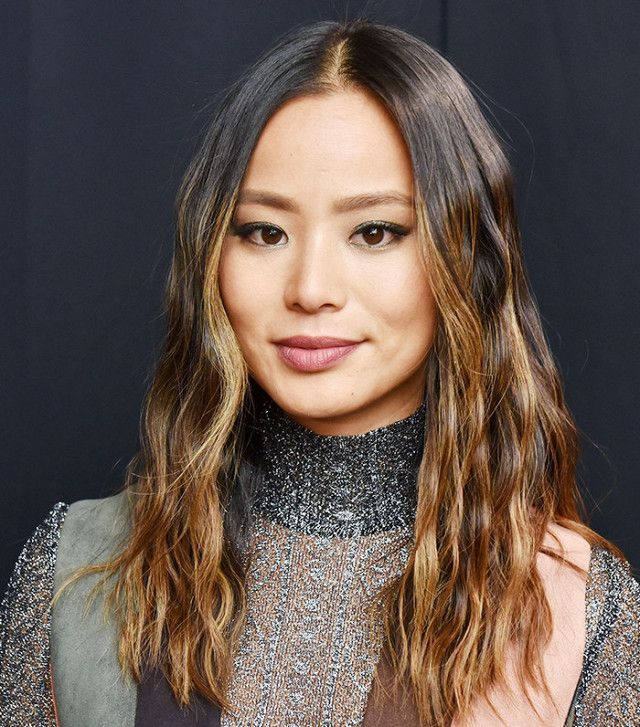 Jamie Chung shows off her tigereye hair color with caramel highlights and a warm...