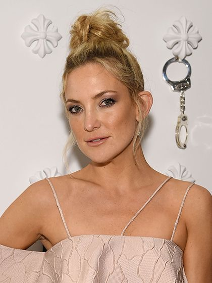 Kate Hudson Tousled Topknot with sun-kissed cheeks | allure.com