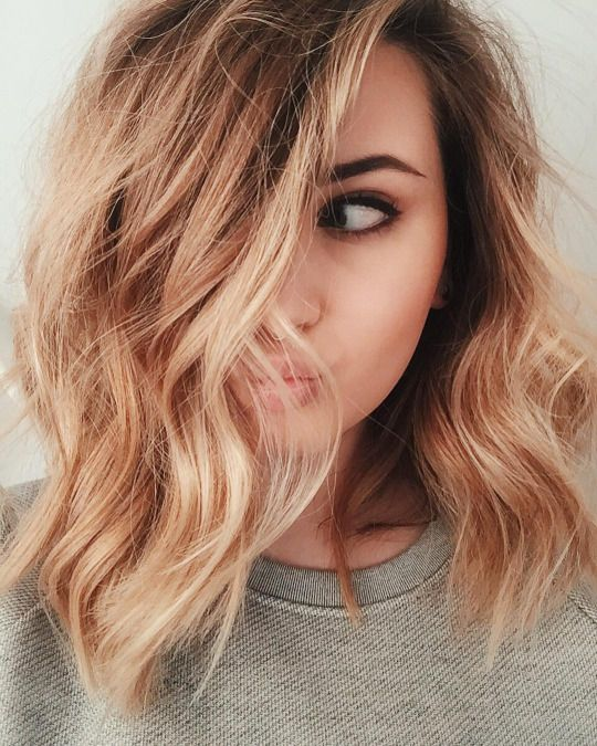 Lob haircut with loose waves and a side part