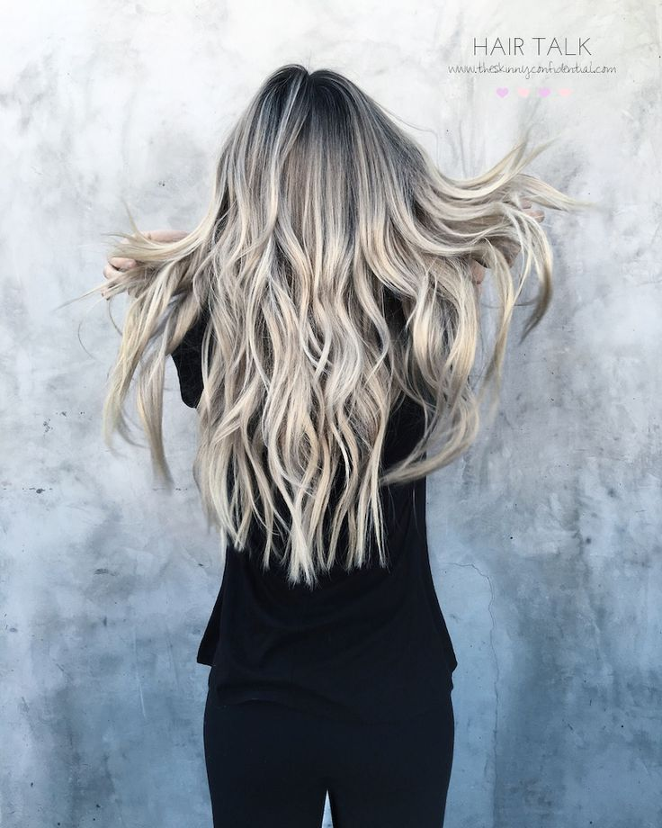 Long blonde hair with loose waves.