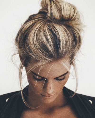 Loose top bun for long hair.