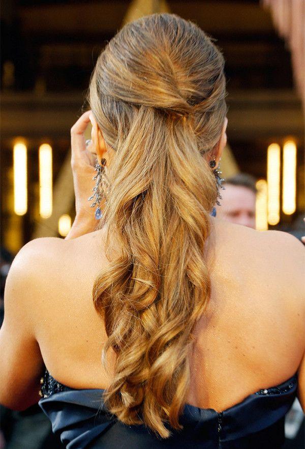 Loose waves cascade down Sofia Vergara's from a styled scalp, creating an al...