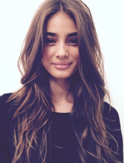 Loose waves with long layers and a center part. | The Little Black Dress