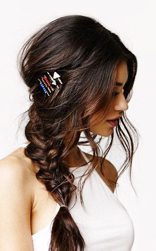Loving this boho chic hair look that features a big braid and bobby pins