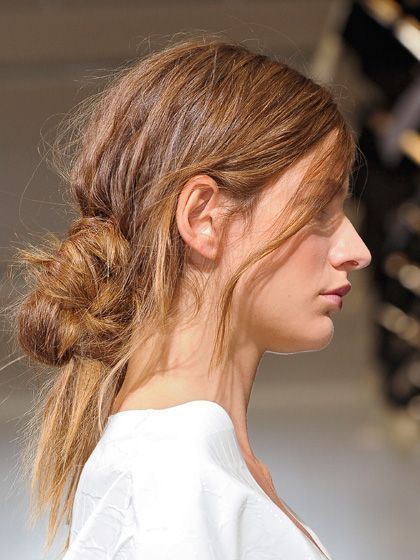 low, messy updo hairstyle - Marni | allure.com
