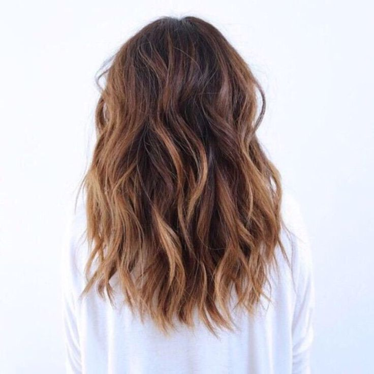 Medium-long hair cut with chopped layers and loose waves