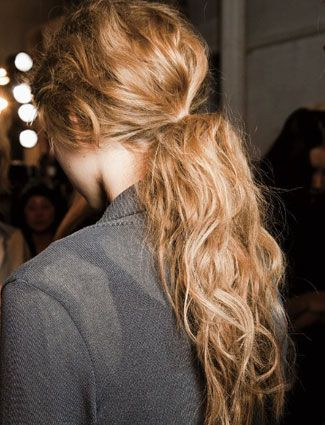 Messy low pony tail with loose waves