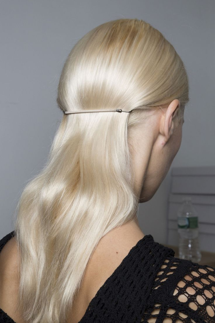 Platinum blond hair styled with a minimalist accessory