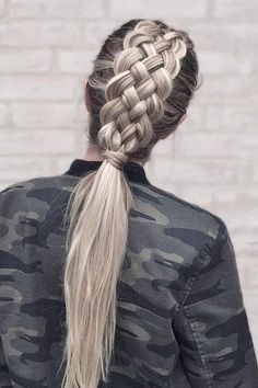 silver four strand braid that falls into a sleek low ponytail