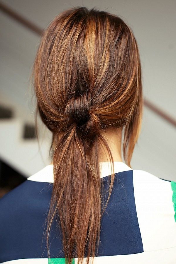 The double-knotted ponytail is a chic alternative to the traditional low ponytai...