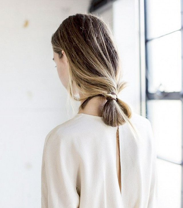 This loose bun is unexpectedly polished, thanks to sleek strands and megawatt sh...