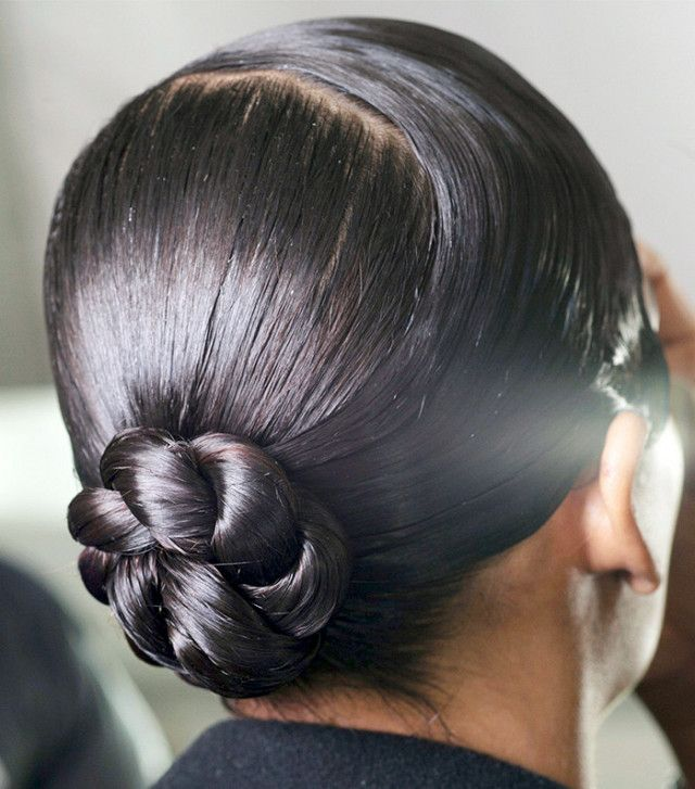 This slicked-back bun is sleek enough to wear to work and cool enough to last th...