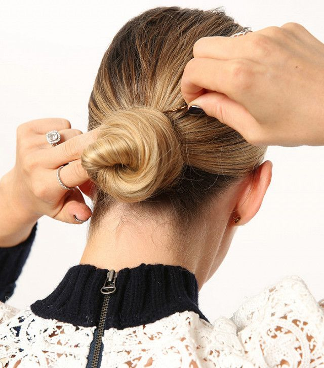 This style is perfect for those who love a sleek bun