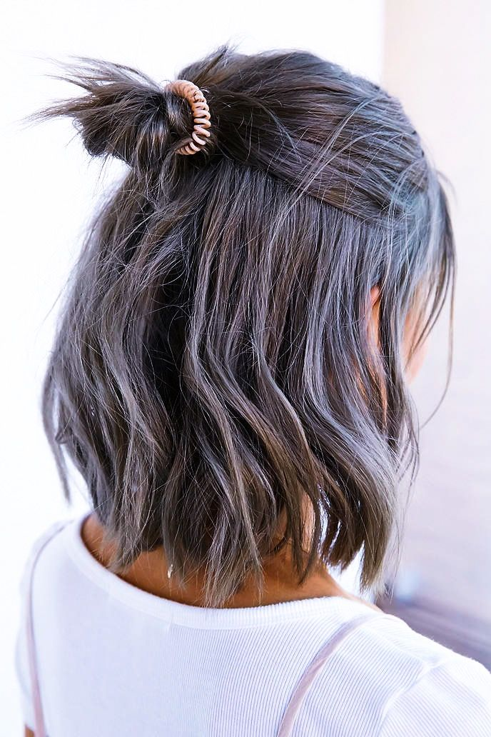 Try the pastel hair color trend with lavender purple locks
