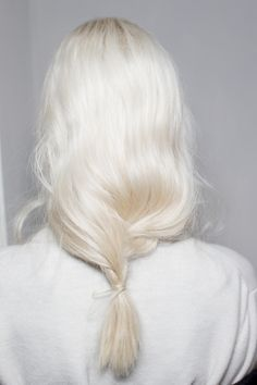 White hair and a loose, low ponytail