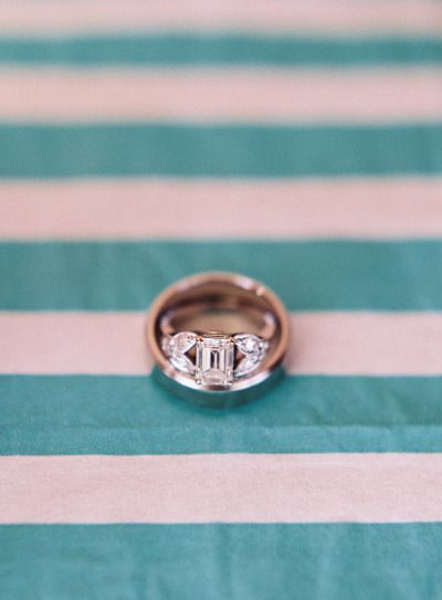 Emerald cut center and double marquise sides: www.stylemepretty...