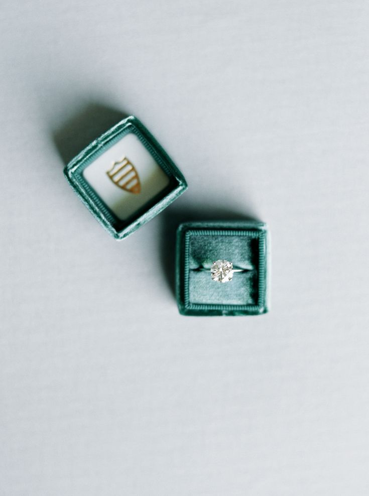 emerald green velvet ring box, solitaire engagement ring | Photography: Ashley S...