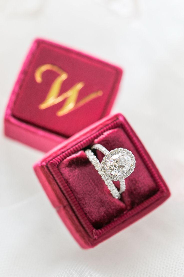 Oval-cut diamond ring in a halo setting: Photography: Amalie Orrange Photography...