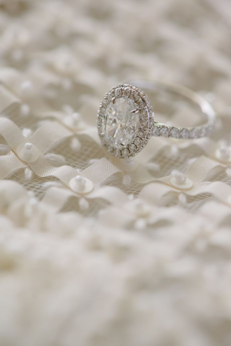 Oval diamond in halo setting engagement ring: Photography: darinimages - www.dar...