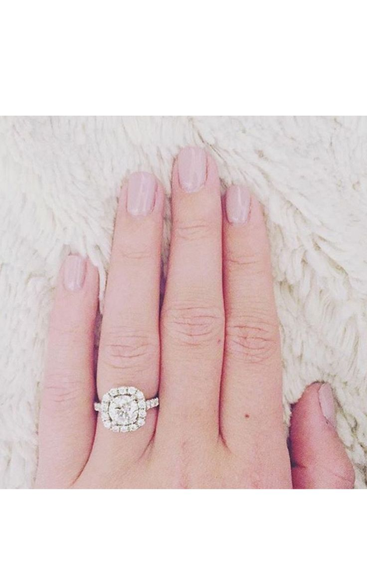 Sparkly halo engagement ring: www.stylemepretty...