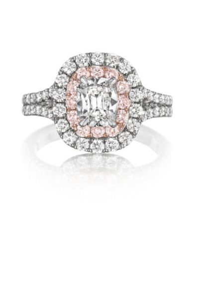 The pink accents in this Henri Daussi engagement ring is every little girl's dre...