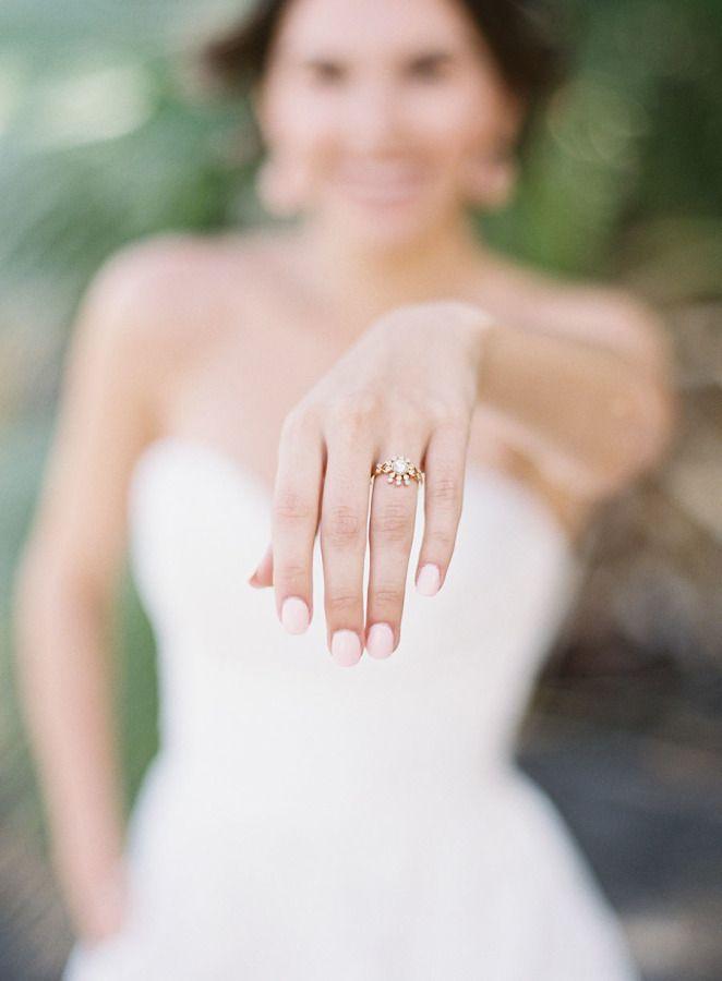 Unique gold sunburst engagement ring: www.stylemepretty... | Photography: Oliver...