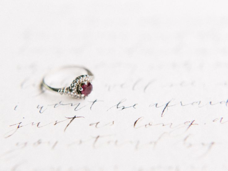 vintage garnet engagement ring in platinum | Photography: Koman Photography