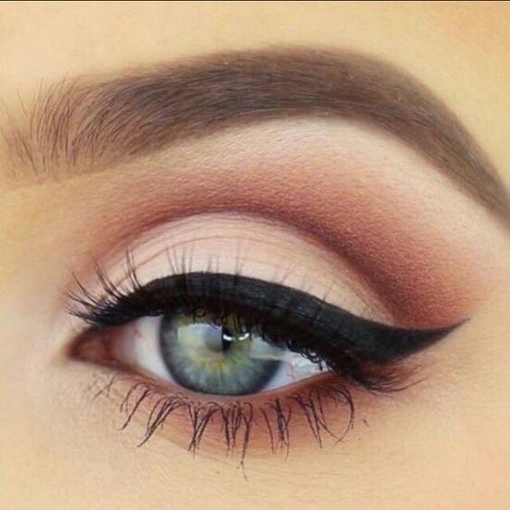 Pretty neutral/pink smokey eye look! Try Lily Lolo's Smoke and Mirrors Eye P...