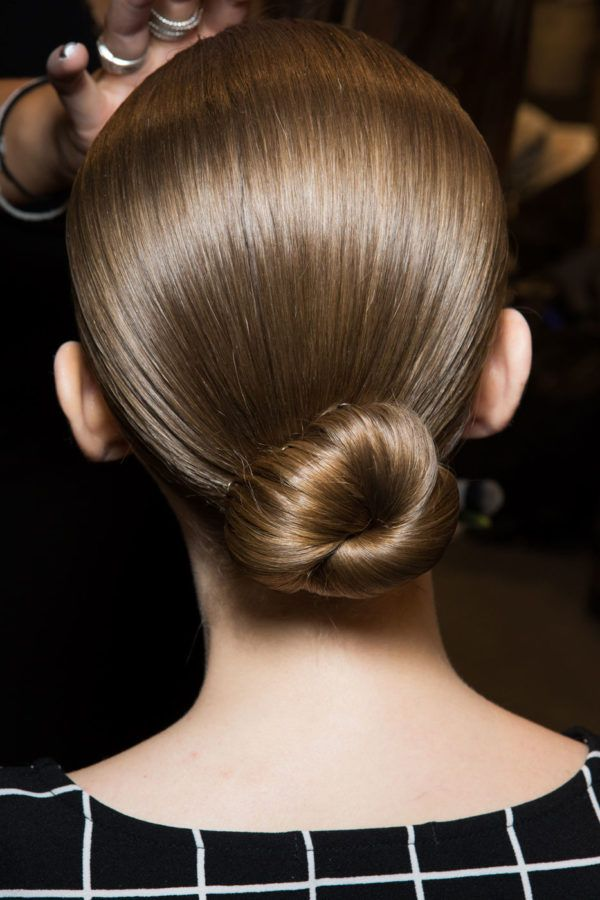 A sleek bun never fails to make for a polished look in seconds.