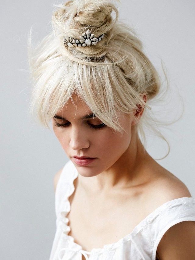 A stunning messy topknot with bangs is perfectly accessorized with this art deco...