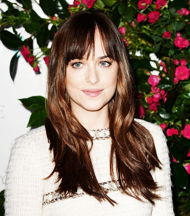 Dakota Johnson's version of the shag with bangs is tousled, choppy, and long...