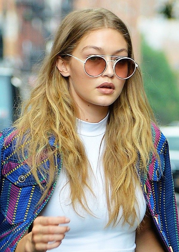 Gigi Hadid knows that the most flattering way to frame a round face is with tous...