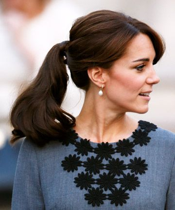 Kate Middleton shows off her side swept bangs and full ponytail