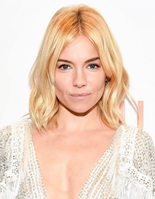 Sienna Miller styles her shag into soft-waves and it looks stunning
