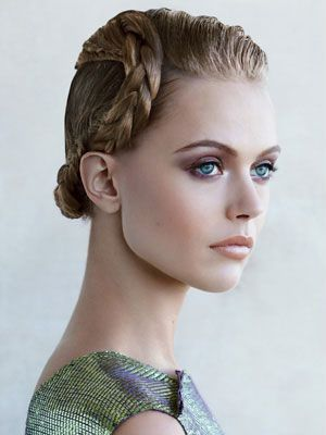 This sleek updo with a polished braid is so stunning