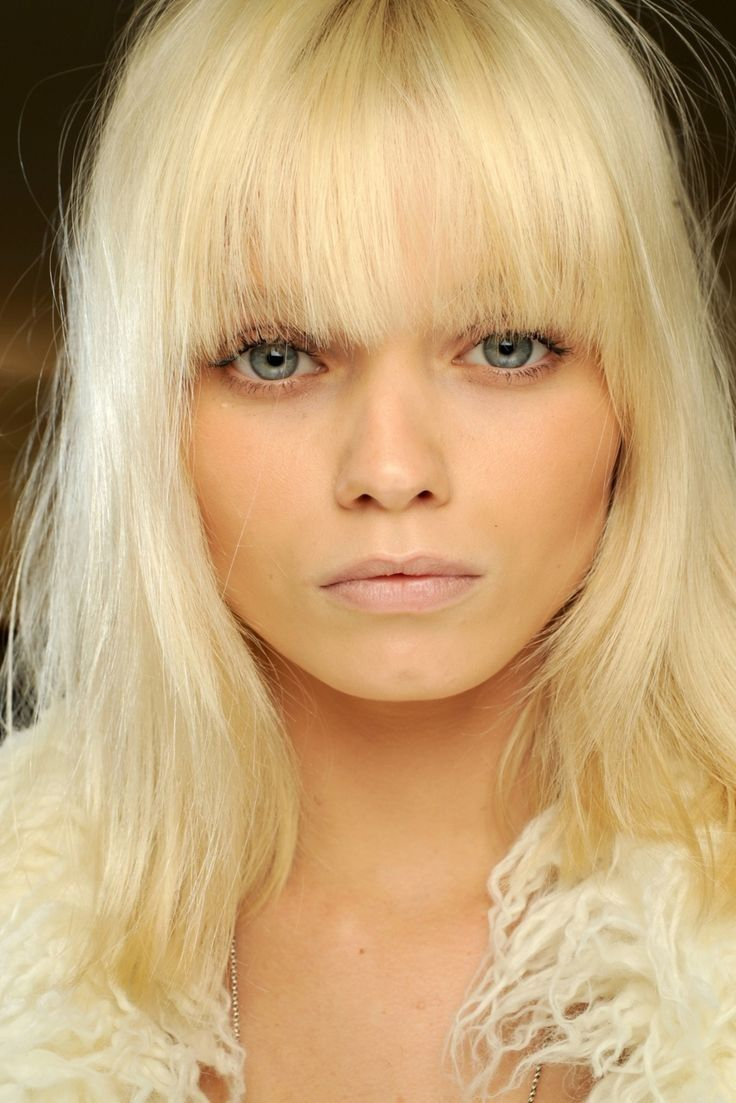 Abbey Lee Kershaw's platinum blonde tousled hair and heavy fringe