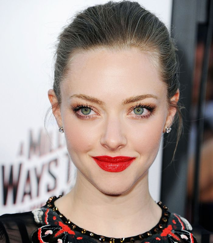 Amanda Seyfried looks gorgeous with an elegant updo and a bright red lip