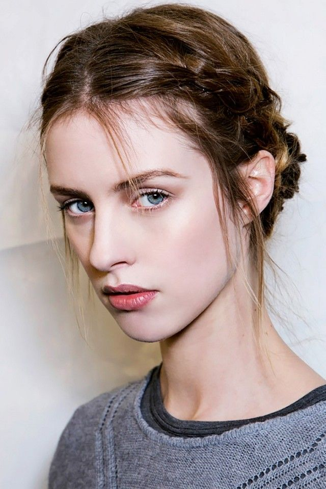 Braided crowns look more romantic when a few wispy strands are left out