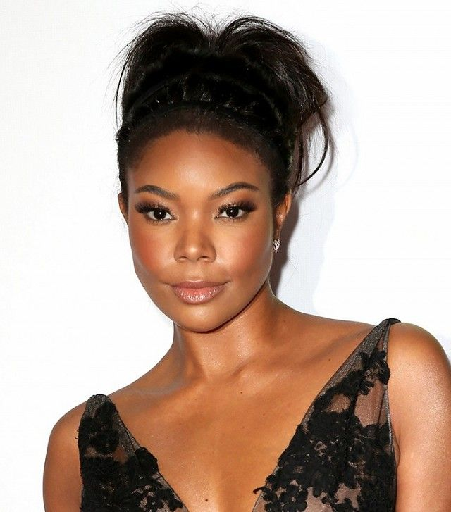 Gabrielle Union's gorgeous glowing skin, glossy lips, and messy updo are all...