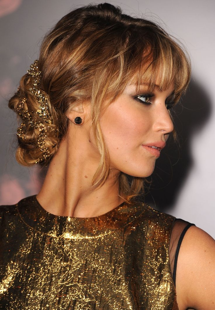 Jennifer Lawrence is giving off major Grecian goddess vibes as she wears her hai...