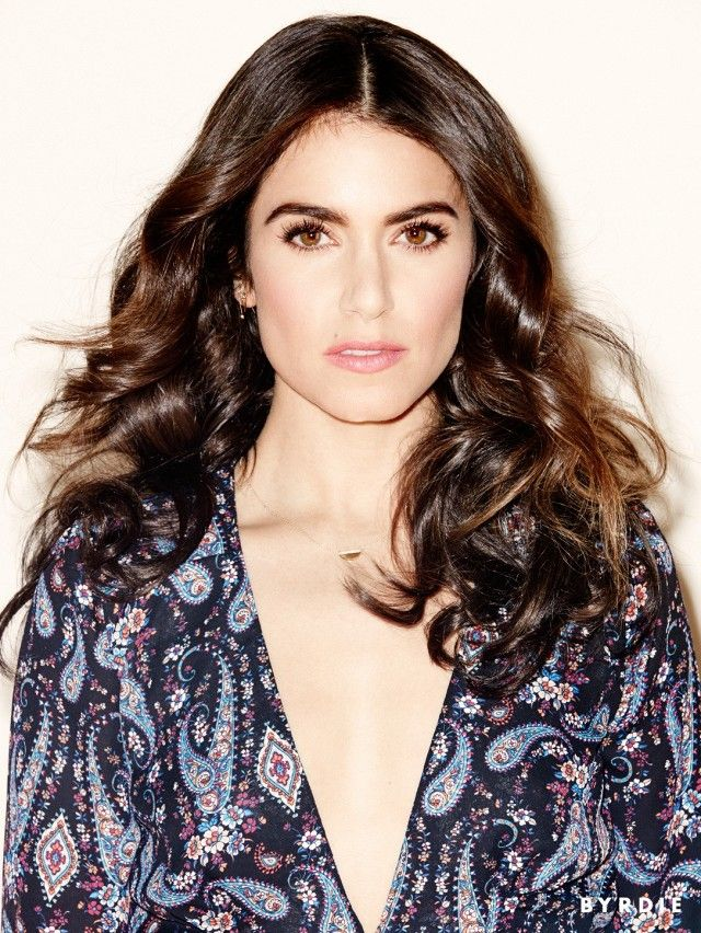 Nikki Reed goes for a stunning '70s Bohemia look complete with big curls, bo...