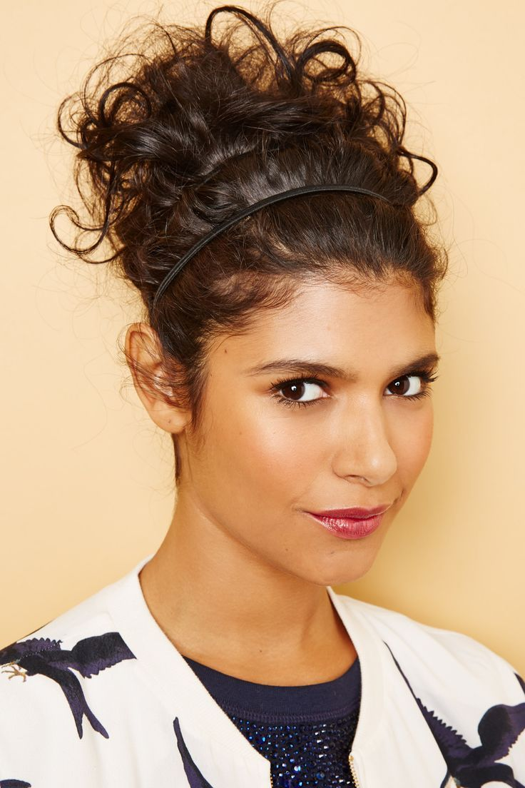 Pull your hair back into a messy bun, then keep strands in place with a no-slip-...