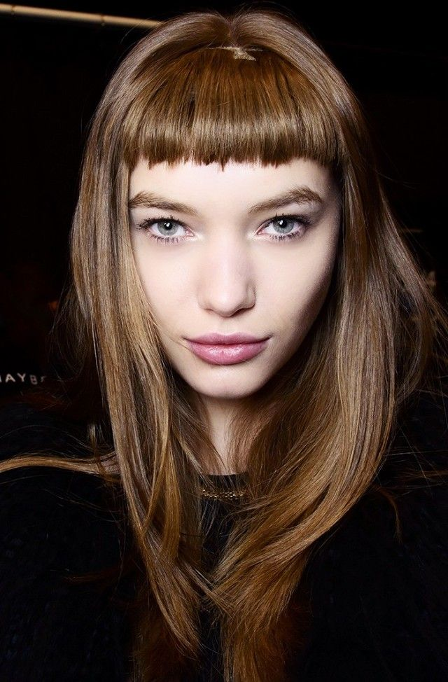 This retro inspired cut features baby bangs and lots of length