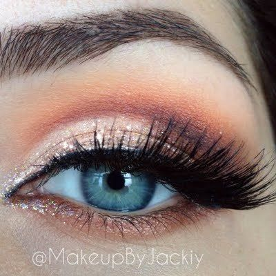Smokey eye makeup with winged out eyeliner. Apply a darker shade in the crease A...